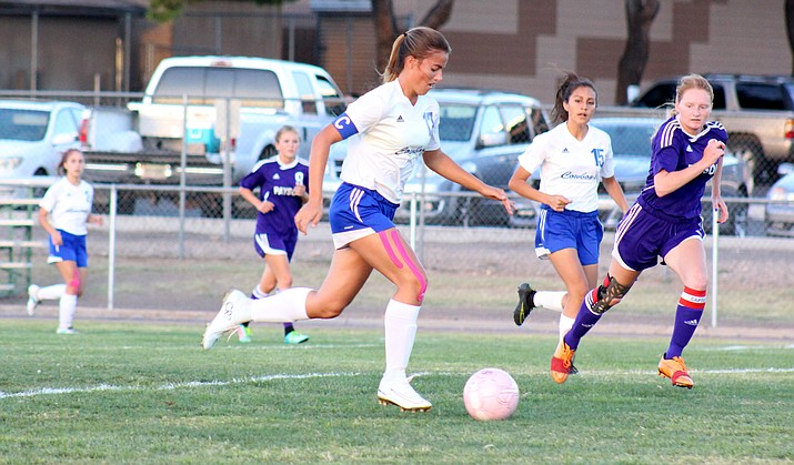 Camp Verde senior Alden Teeters dribbles past the defense en route to scoring in the Cowboys' 6-0 win over Payson on Thursday. Teeters was one of five goal scorers for CV against the Longhorns. (VVN/James Kelley)
