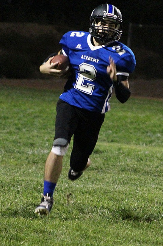 Kingman Academy's Stevie Wustig ran for 183 yards and two touchdowns Friday night in a 56-28 win at Sedona Red Rock.
