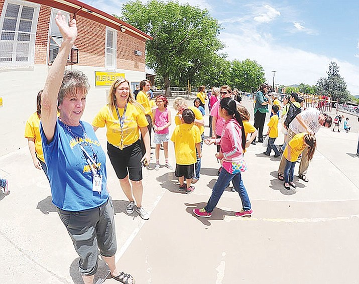 Staff say goodbye to students on the last day of school at Miller Valley School in Prescott in May 2015. (Les Stukenberg/Courier, file)