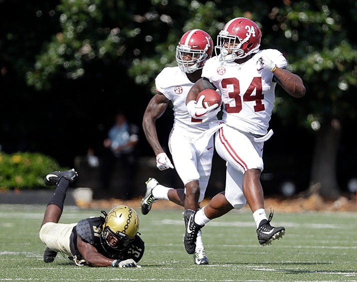 Alabama running back Damien Harris (34) runs 61 yards for a touchdown ahead of Vanderbilt cornerback Tre Herndon (31) during the first half of an NCAA college football game Saturday, Sept. 23, in Nashville, Tenn. (Mark Humphrey/AP)