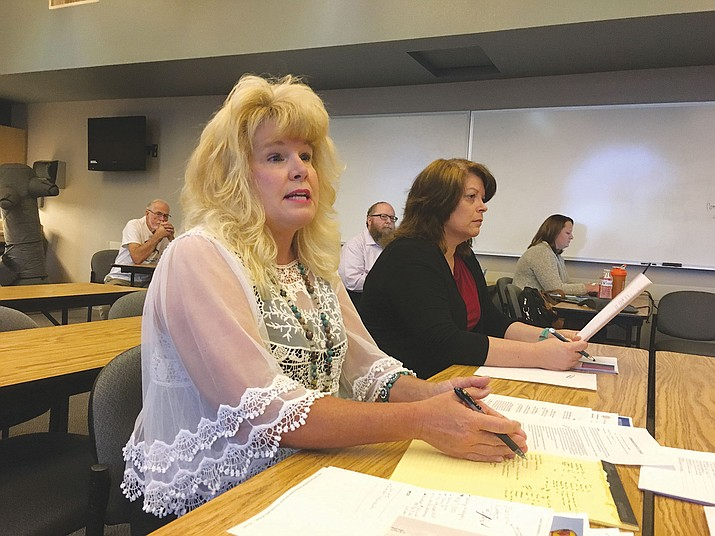 Jackie Walker, director of City of Kingman human resources and risk management, lays out the process for recruiting a new city manager Friday at a special meeting of City Council at Kingman Police Department. The item will be placed on the Council's Oct. 3 agenda.