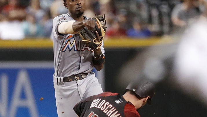 Marlins delay D-backs clinch