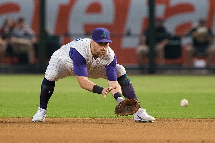 Diamondbacks' second baseman Brandon Drury fields a ground ball Sept. 14 against the Rockies. Drury hit his 13th home run of the season in Saturday's loss to the Marlins.