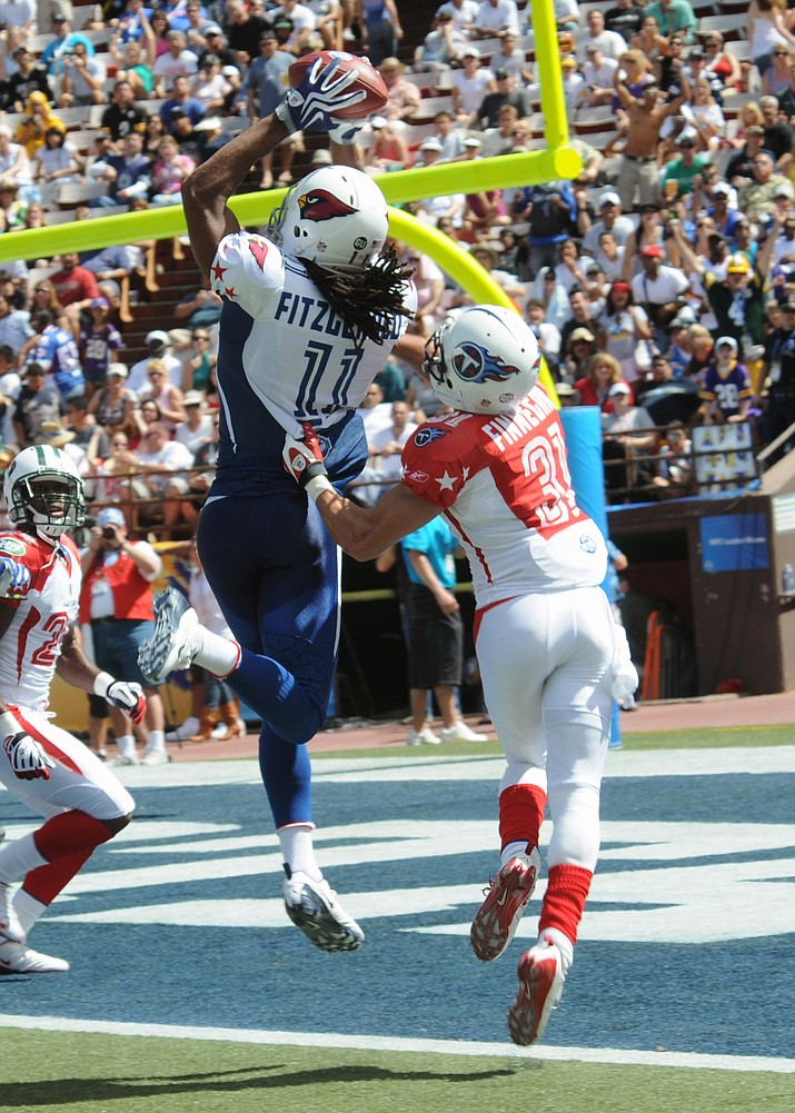 Arizona Cardinals wide receiver Larry Fitzgerald catches a touchdown pass from New Orleans Saints quarterback Drew Brees during the fourth quarter of the National Football League Pro Bowl Feb. 8, 2009, at Aloha Stadium in Honolulu.
