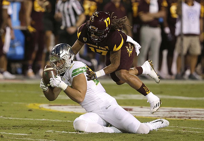 Oregon tight end Jacob Breeland cannot make the catch in front of Arizona State defensive back J'Marcus Rhodes (17) during the first half during an NCAA college football game, Saturday, Sept. 23, in Tempe.