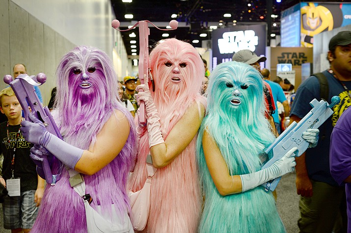 "Costumes will no doubt be on display as Comic Con comes to Prescott this Saturday, Sept. 30. Here, Ashley Bailey, from left, Jacquie Ogle and Catherine Fisher, dressed as ""Chewie's Angels"" attend the 2016 Comic-Con International in San Diego. (Photo by Al Powers/Invision/AP)"