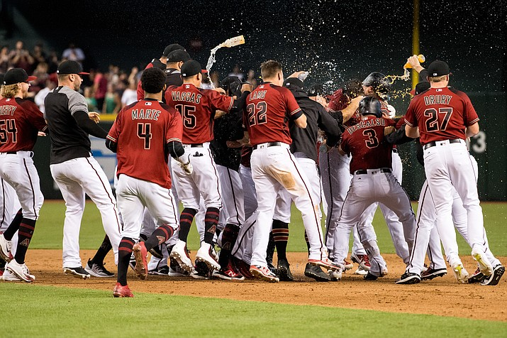 The D-backs defeated the Marlins 3-2 Sunday and clinch a Wild Card spot in the postseason.