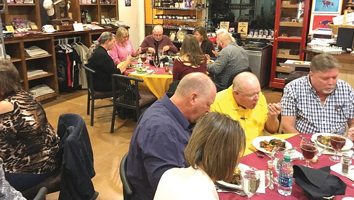 After the cigars were put out, those who attended gathered inside the distillery for dinner.