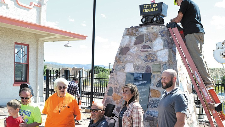 Just some of the people who helped bring the monument to life. From left to right; Riley Finn, Phillip Shilling, Historical Preservation Committee members Nan Russell (orange shirt), Bill Shilling, Barb Charon and Shawn Walsh. C. Russell is on the ladder bolting down the lid of the monument.