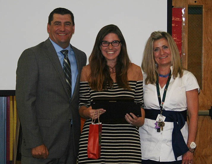 Lindsey Brewer, center, pictured with Superintendent Dan Streeter and Principal Candice Stump. (Courtesy)