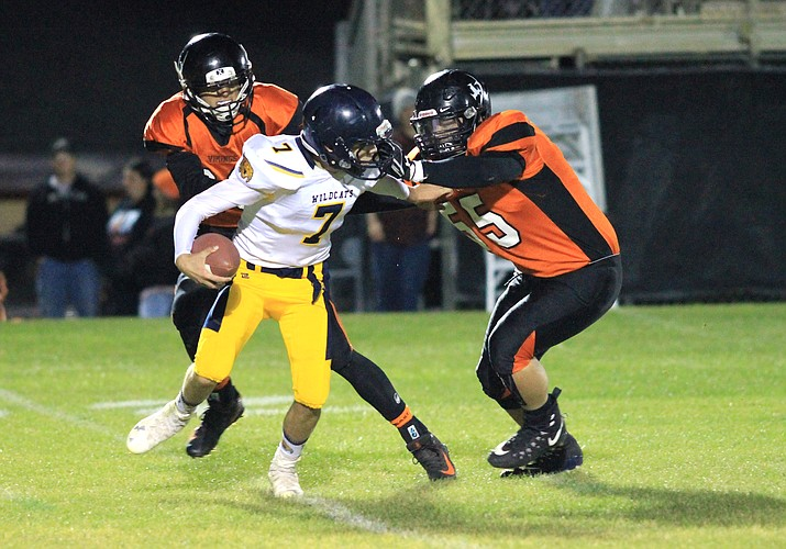 Vikings Emmanuel Flores and Zack Perkins take down the Joseph City Wildcat's quarterback.