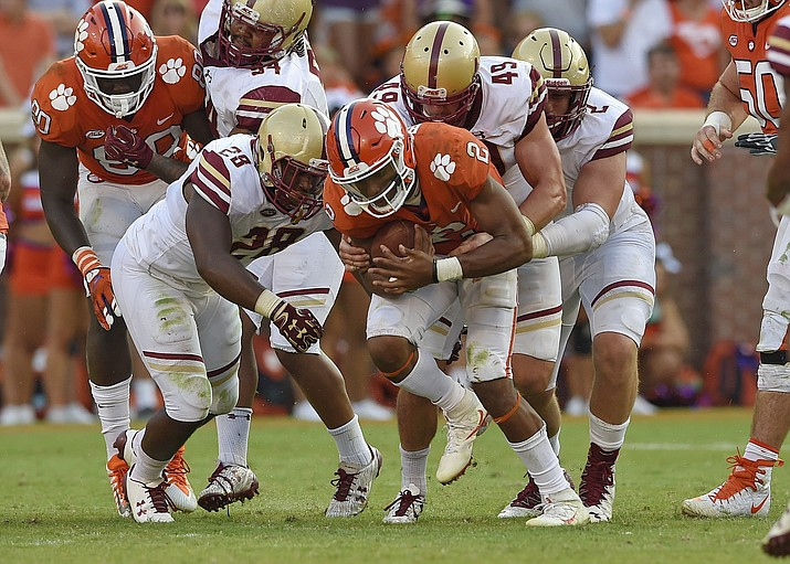 Clemson's Kelly Bryant charges forward for a first down during the first half of an NCAA college football game against Boston College Saturday, Sept. 23, 2017, in Clemson, S.C. Clemson won 34-7. (AP Photo/Richard Shiro)