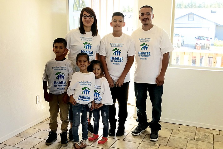 Back row, from left: Christina, Jose, Jr., Jose, Anthony, Juana and Veronica. The Hernandez-Martinez family is the fourth family Williams Habitat for Humanity has helped with housing needs.