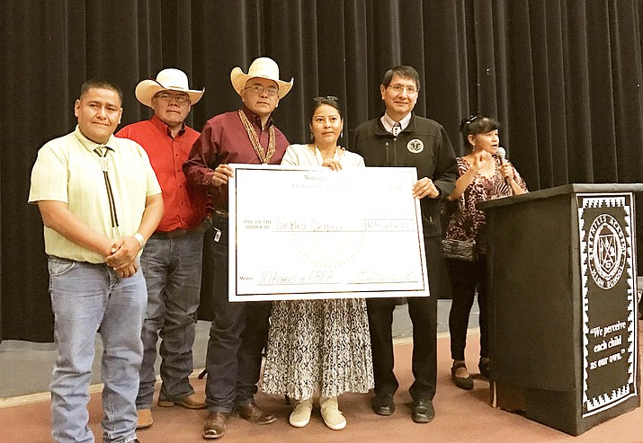 A check for $225,000 for construction of 10 homes in Bennett Freeze area is presented by the Navajo Nation.