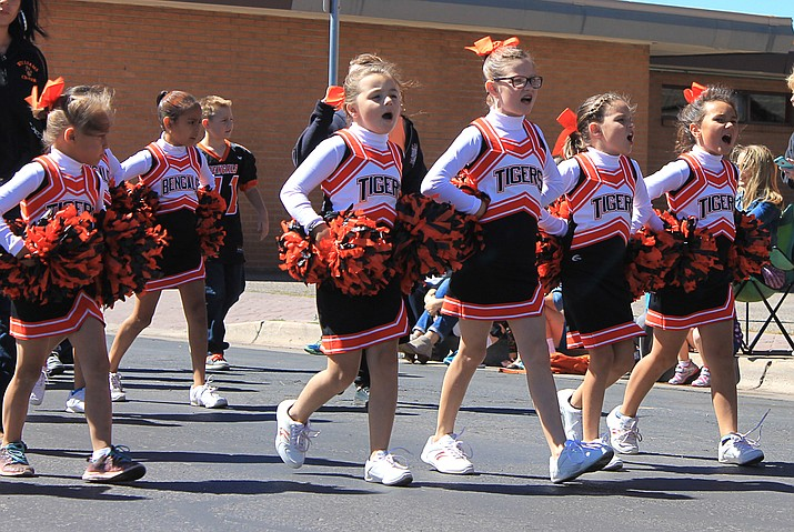 Youth Football cheerleaders lead the way during the 2017 homecoming parade.