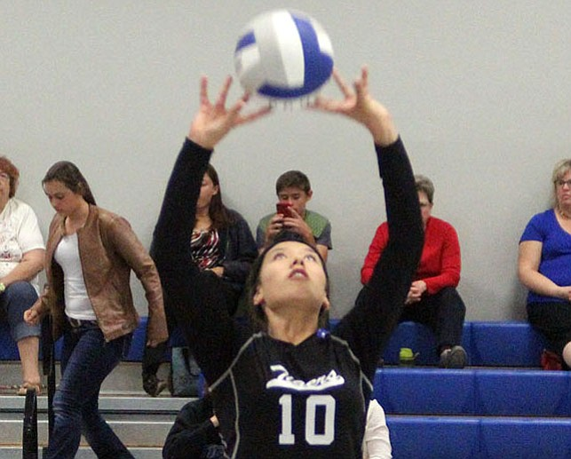 Kingman Academy's Shaunti Short sets the ball Tuesday against Antelope. The Lady Tigers won 3-0 to pick up their first 2A West Region victory.