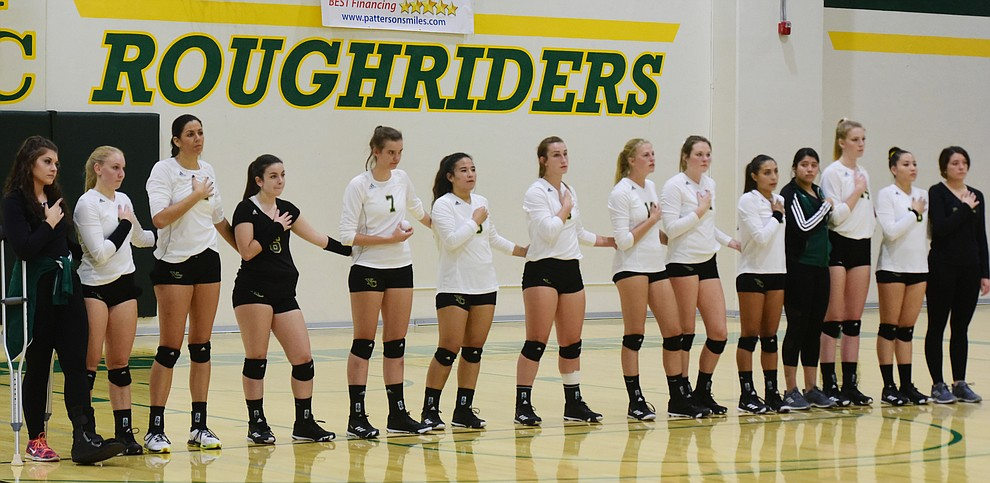 Yavapai volleyball team stands for the National Anthem as the Roughriders take on Scottsdale Community College Wednesday, September 27 in Prescott. (Les Stukenberg/Courier)
