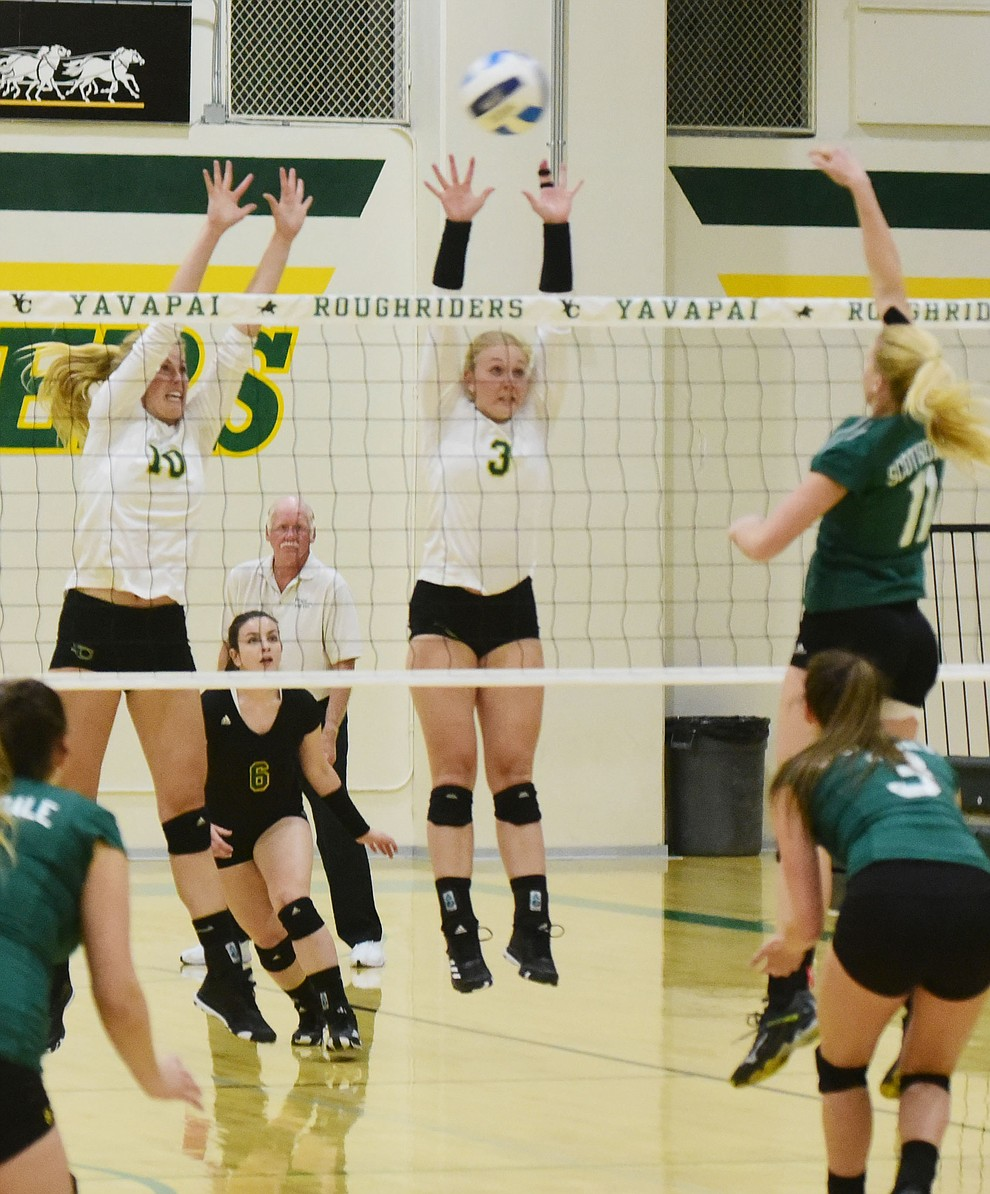 Yavapai's Bailey Anderson (10) and Jailynn Butler (3) go for a block as the Roughriders take on Scottsdale Community College Wednesday, September 27 in Prescott. (Les Stukenberg/Courier)