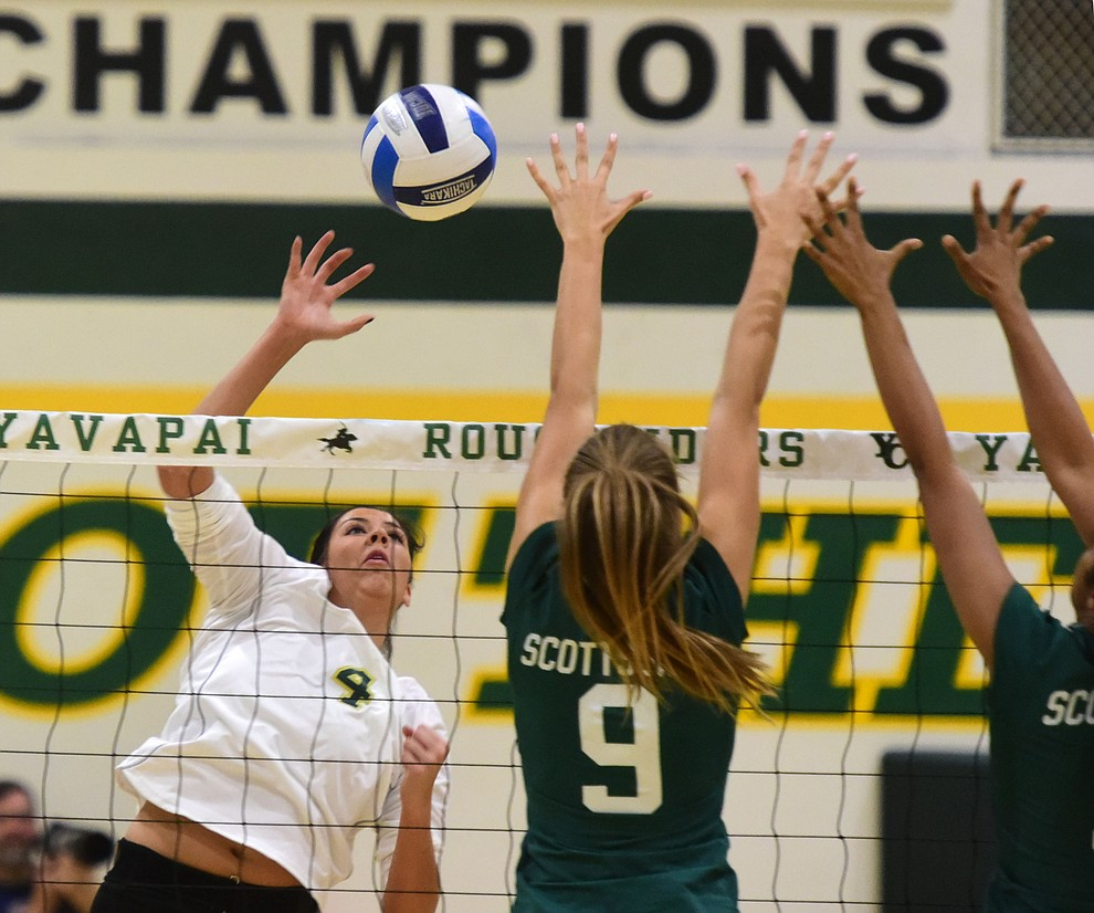 Yavapai's Kaytlin Lost (4) gets a kill as the Roughriders take on Scottsdale Community College Wednesday, September 27 in Prescott. (Les Stukenberg/Courier)