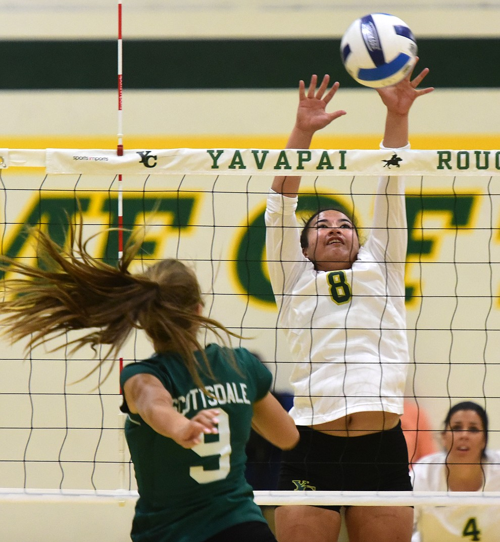 Yavapai's Kanani Hiapo (8) gets a block on Mesa Rohrer (9) as the Roughriders take on Scottsdale Community College Wednesday, September 27 in Prescott. (Les Stukenberg/Courier)