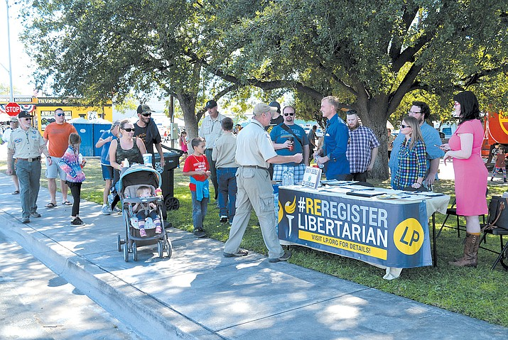 Local Libertarians greet post-parade passersby at Locomotive Park Saturday.