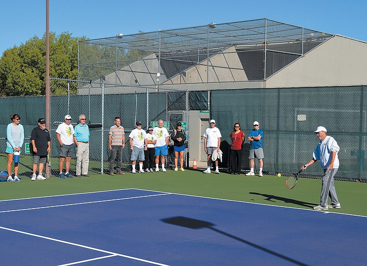 Kingman Tennis Club President Brooke Fix hits the ceremonial first ball of the resurfaced tennis courts at Centennial Park Wednesday.
