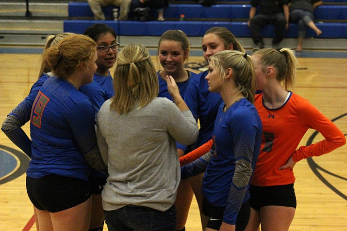 The Chino Valley volleyball team gets together during a timeout against the Cowboys on Wednesday, Sept. 28, 2017, in Camp Verde. (James Kelley/Verde Independent)