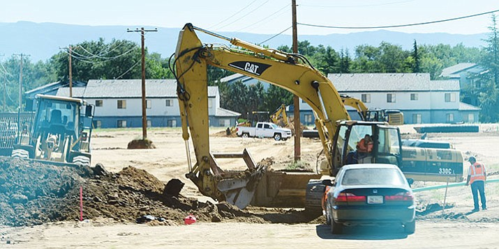 Crews work on the infrastructure where the future Deep Well Ranch subdivision is planned to be centered. (Les Stukenberg/Courier)