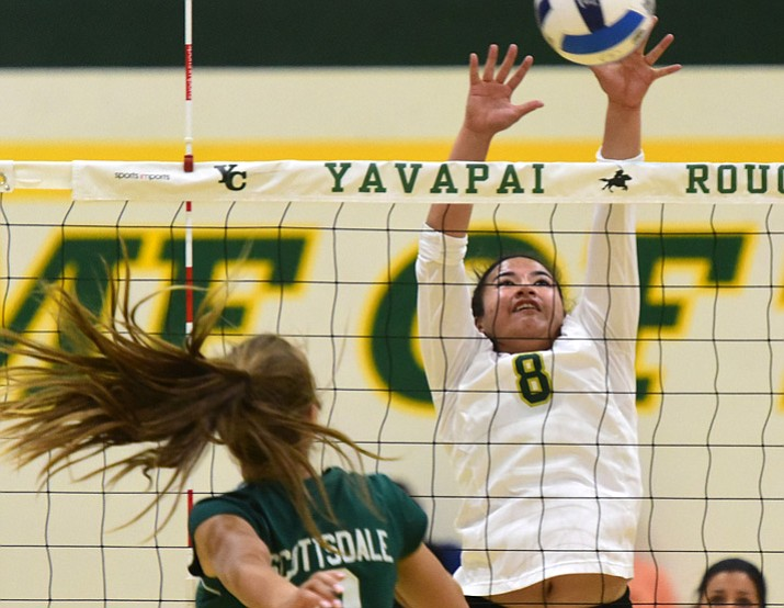 Yavapai College volleyball player Kanani Hiapo (8) gets a block on Mesa Rohrer (9) as the Roughriders take on Scottsdale Community College on Wednesday, Sept. 27, 2017, in Prescott. (Les Stukenberg/Courier)