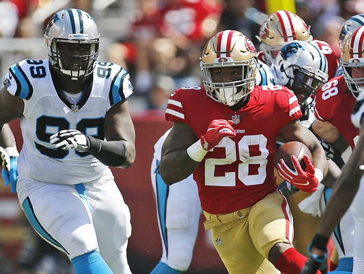 In this Sept. 10, 2017, file photo, San Francisco 49ers running back Carlos Hyde (28) runs against the Carolina Panthers during the first half of an NFL football game in Santa Clara, Calif. The 49ers face the Arizona Cardinals on Sunday. (Tony Avelar/AP, File)