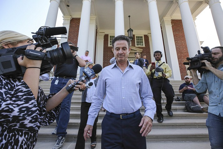 Louisville men's basketball coach Rick Pitino leaves Grawemeyer Hall after having a meeting with the university's interim president Greg Postel on Wednesday, Sept. 27, 2017, in Louisville. Ky. Louisville announced Wednesday that they have placed Pitino and athletic director Tom Jurich on administrative leave amid a federal bribery investigation. (Michael Clevenger/AP)