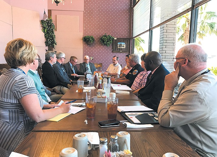 GEO Group representatives met with Kingman leadership at Calico's Wednesday.