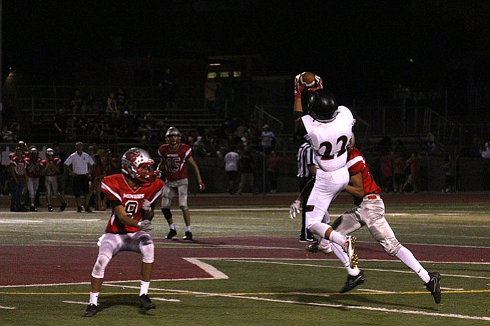 Bryan Price (22) catches a pass as Bradshaw Mountain plays Mingus on Friday, Sept. 29, in Cottonwood.