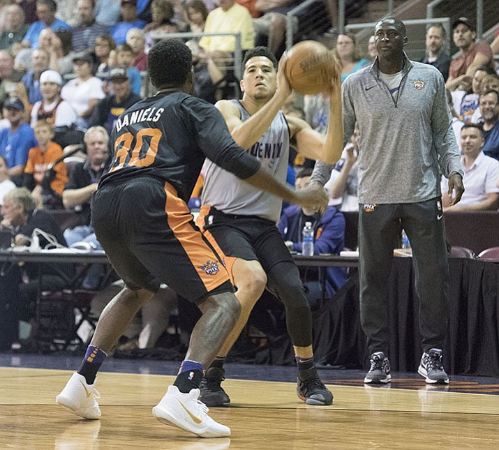 Devin Booker looks to shoot a 3-pointer during the Phoenix Suns scrimmage Friday, Sept. 29, at the Prescott Valley Event Center.