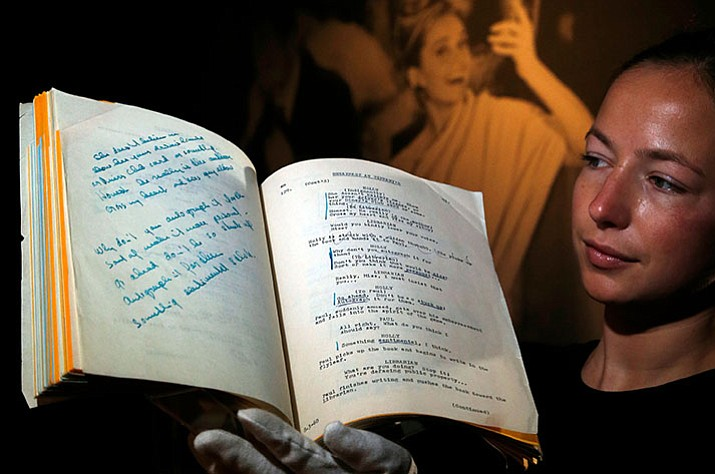 """A script for the film 'Breakfast at Tiffany's' owned by the iconic actress Audrey Hepburn is displayed at Christie's auction house in London. Fans of Hollywood glamour have snapped up mementos from the collection of the late Audrey Hepburn at a London auction. The star's personal shooting script for """"Breakfast at Tiffany's"""" sold for 632,750 pounds ($846,619) at Christie's on Wednesday, Sept. 27, seven times its pre-sale estimate and one of many lots that smashed expectations."""