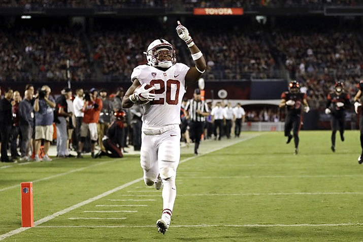 In this Sept. 16, file photo, Stanford running back Bryce Love scores a touchdown during the second half of an NCAA college football game against San Diego State in San Diego.