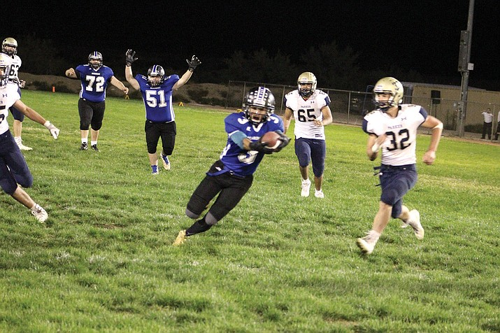 Kingman Academy's Gabe Imus scores the game-winning touchdown Friday against Parker. Imus caught 10 passes for 132 yards and three touchdowns.