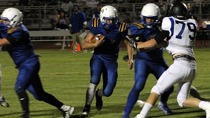 Kingman's Darrell Mitchell finished 6-of-15 for 102 yards and a touchdown in a 52-12 loss Friday at Wickenburg.