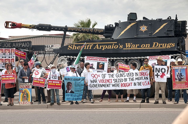 In this photo from 2012, protests are held in front of the jail and the offices of former Sheriff Joe Arpaio. An audit report produced in a racial profiling case against the Maricopa County Sheriff's Office say Hispanics are more likely to be searched and arrested by sheriff's deputies in traffic stops than white people.