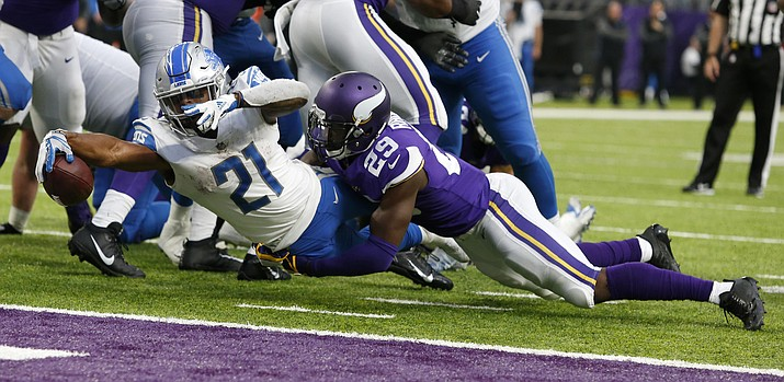 Detroit Lions running back Ameer Abdullah (21) scores on a 3-yard touchdown run ahead of Minnesota Vikings cornerback Xavier Rhodes (29) during the second half of an NFL football game, Sunday, Oct. 1, 2017, in Minneapolis. (Bruce Kluckhohn/AP)