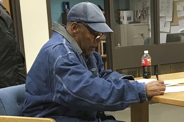 Former football legend O.J. Simpson signs documents at the Lovelock Correctional Center, Saturday, Sept. 30, 2017, in Lovelock, Nev. Simpson was released from the Lovelock Correctional Center in northern Nevada early Sunday, Oct. 1, 2017. (Brooke Keast/Nevada Department of Corrections via AP)