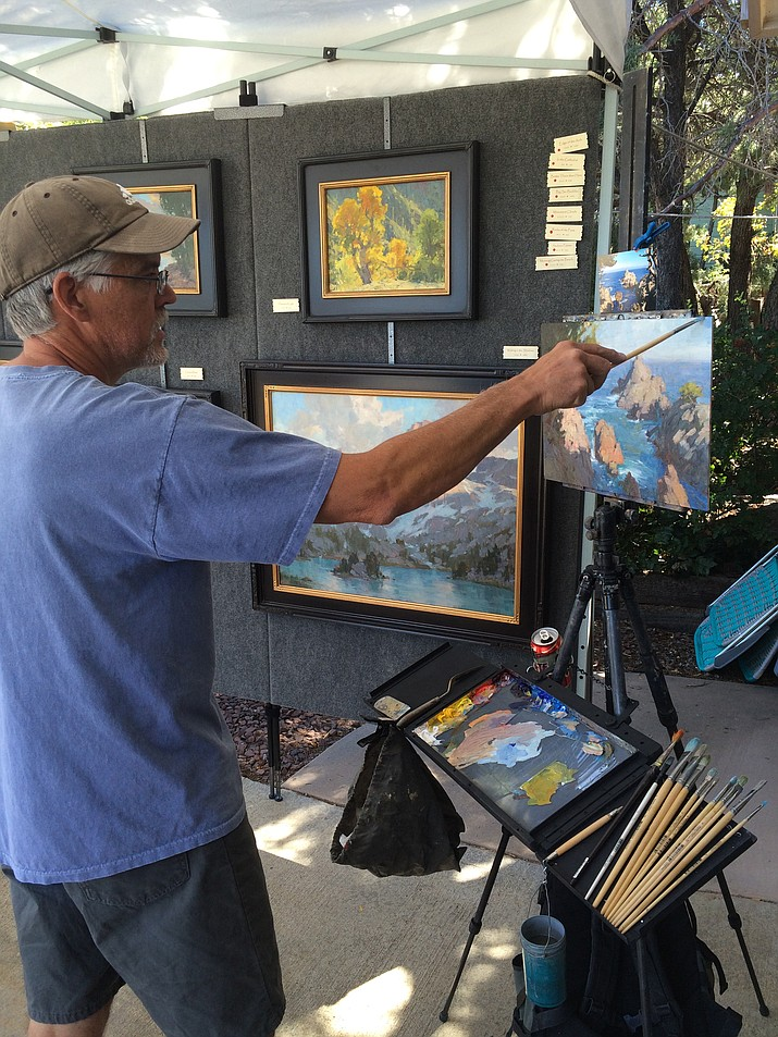 Bill Cramer puts the finishing touches on a painting during the 2015 Prescott Area Artists' Studio Tour. (Jason Wheeler/Courier)