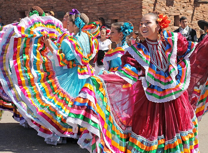 Dancers perform the traditional Mexican hat dance in colorful costumes at Grand Canyon National Park's Hispanic Heritage Month celebration.