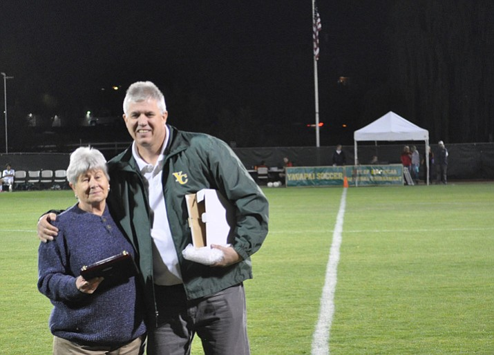 Lynn Merritt, left, and Yavapai College athletic director Brad Clifford pose for a photo Saturday, Sept. 30, 2017, at Mountain Valley Park in Prescott Valley. Merritt was recently inducted into the ACCAC Hall of Fame. (Yavapai Athletics/Courtesy)