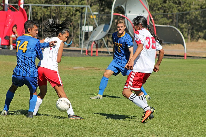 Jessica Richardson blocks a player while Keebahe takes the ball.