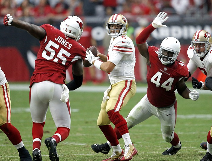 San Francisco 49ers quarterback Brian Hoyer looks to throw as Arizona Cardinals outside linebacker Markus Golden (44) and outside linebacker Chandler Jones (55) pursue during the second half Sunday, Oct. 1, 2017, in Glendale. (Ross D. Franklin/AP)