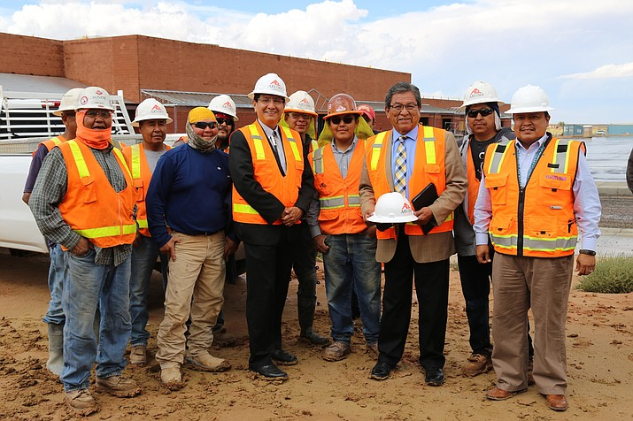Navajo Nation President Russell Begaye (third from right) and vice president Jonathan Nez review progress made on a new shopping center being built just north of the intersections of AZ 264 and US 191. Submitted photo
