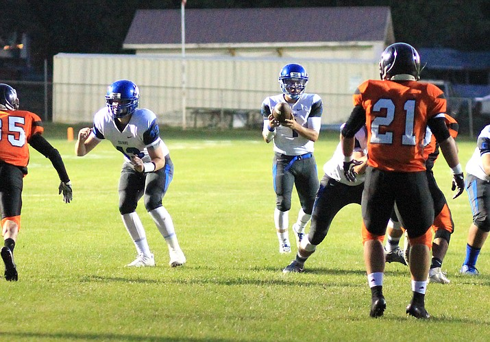Bagdad quarterback Israel Loveall looks to pass against Williams Sept. 1. Lovell broke the national 8-man football record for career passes Sept. 22.
