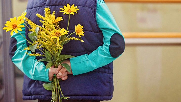 Two young boys timidly walked into the restaurant with a bouquet of flowers. The older boy presented the worker with the flowers and told her they just wanted to thank her for working so hard. (Stock illustration photo)
