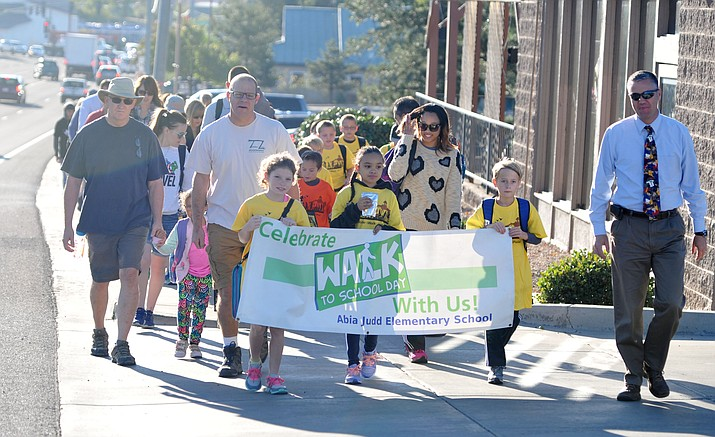 Abia Judd students and parents take part in the annual Walk to School program, sponsored by Prescott Alternative Transportation, Wednesday, Oct. 4, in Prescott. (Les Stukenberg/Courier)